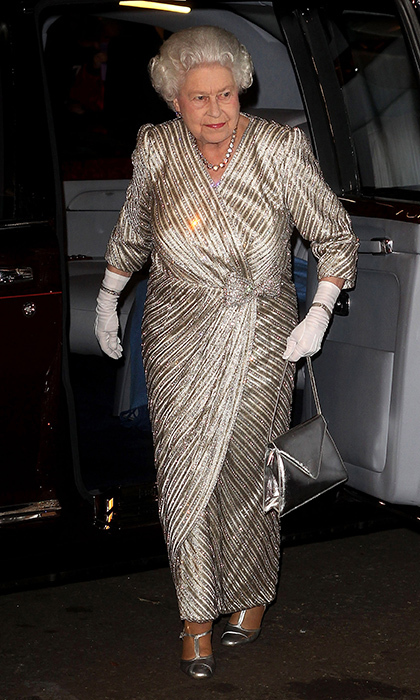 On the throne for 65 years, Queen Elizabeth has seen more than one trend come and go. So for the monarch metallics aren't a passing fad – they're a timeless part of her wardrobe. Here the Queen wears a gold wrap gown with silver purse and shoes for a performance at Royal Albert Hall in November 2012.