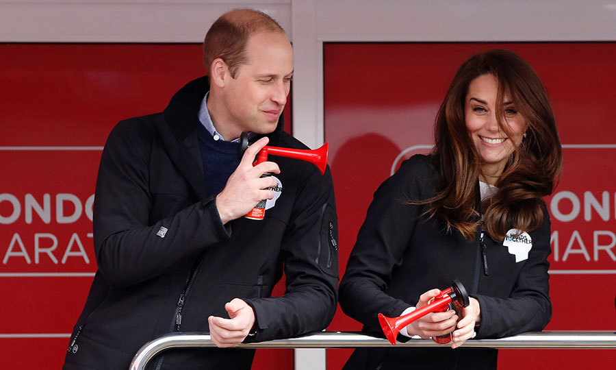 William showed off his playful nature, blowing a red horn at his wife Kate.