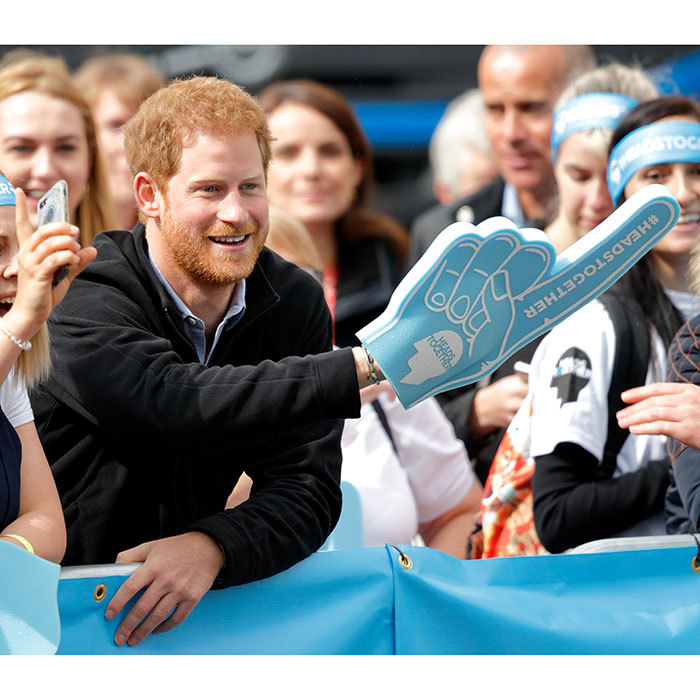 Prince Harry was in full cheerleader mode, waving his Heads Together foam finger. 