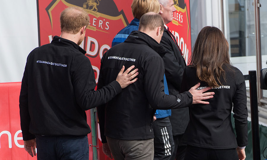 When it comes to the royal trio's mental health charity Heads Together, a main participant in the London marathon, three heads are definitely better than one! Harry, William and Kate show mutual support – literally – with this united front as they left the stage at the Virgin Money London Marathon on April 23, 2017. 