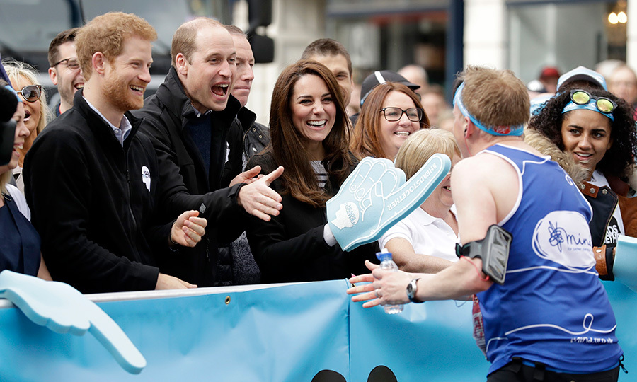 With Duchess Kate in charge of the Heads Together foam finger, the three royals cheered on runners from the sidelines at the London Marathon on April 23, 2017.