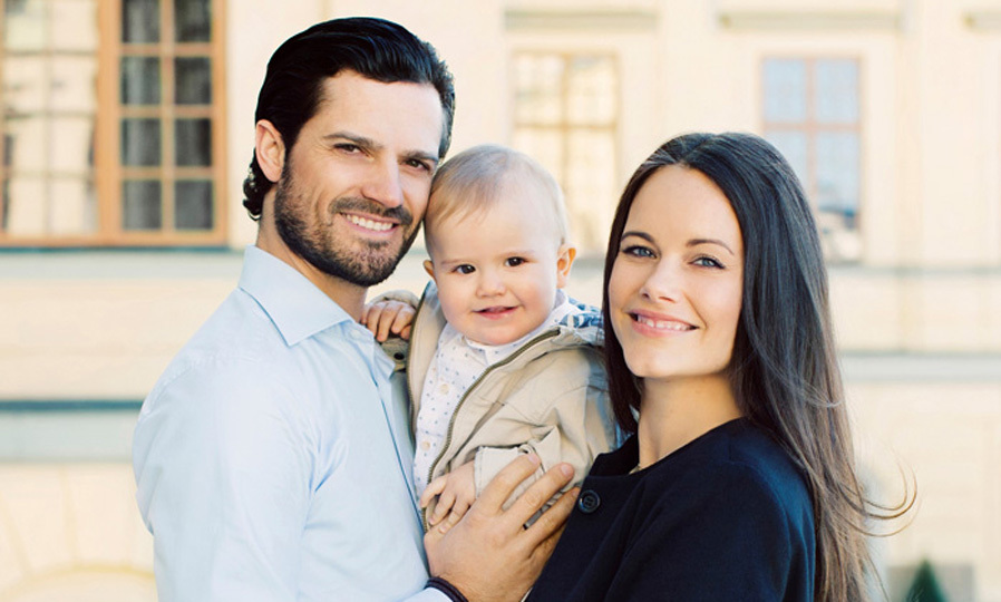 The royal cutie, Prince Alexander, and his parents, Prince Carl Philip and Princess Sofia, look picture perfect posing for a family portrait.