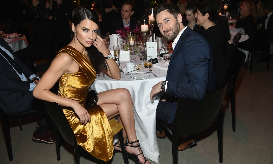 Strike a pose! Adriana Lima and Ryan Eggold worked the camera, from their seats, during the IWC Schaffhausen Tribeca Film Festival Gala at Spring Studios.
