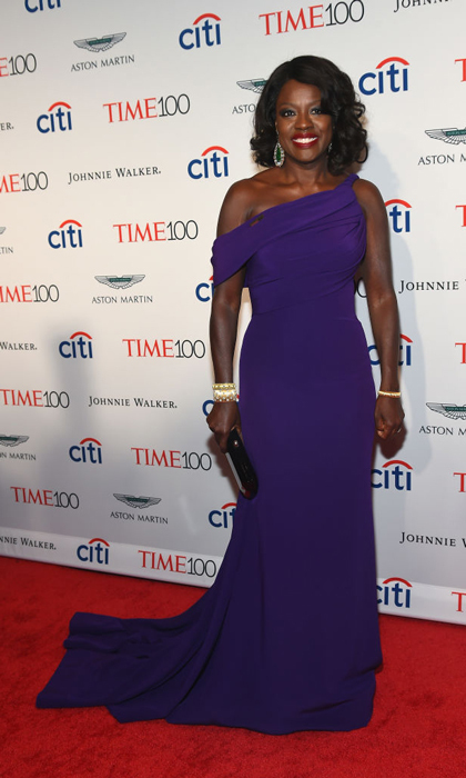 April 25: Viola Davis showed off her toned arms in a purple Armani Prive gown on the red carpet at the TIME 100 Gala.
