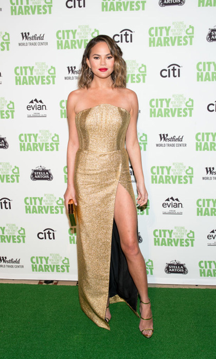 April 25: Chrissy Teigen showed off her statuesque gams in a gold gown at the City Harvest Practical Magic Gala before meeting up with husband and TIME 100 honoree John Legend at that gala.