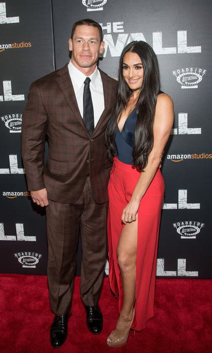 April 27: John Cena had fiancée Nikki Bella by his side at the premiere of <i>The Wall</i> in NYC.