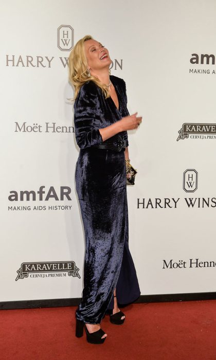 April 27: Kate Moss paired her velvet gown with a black belt and black shoes for the amfAR Gala in São Paulo, Brazil. 