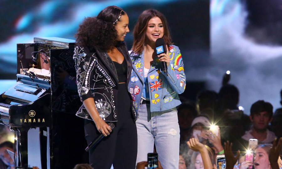 April 27: UNICEF Goodwill Ambassador Selena Gomez introduced Alicia Keys during the WE Day California celebration at the Forum.