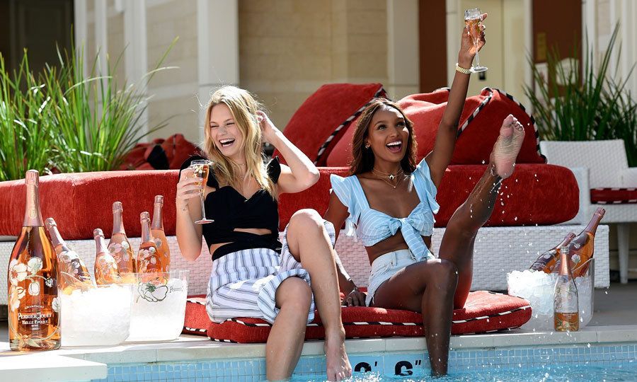 April 27: Nadine Leopold and Jasmine Tookes had a full supply of Perrier Jouet as they hung poolside at Encore Beach Club prior to their celebrating Intrigue Nighclub's one-year anniversary at the Wynn hotel in Las Vegas. 