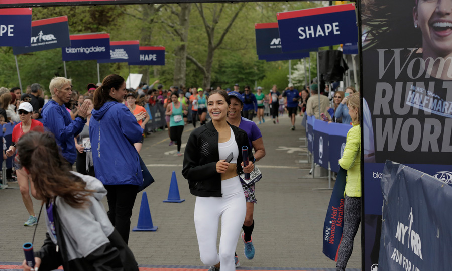 April 30: Olivia Culpo was all smiles as she completed the SHAPE Women's Half Marathon that helped CARE's mission to fight global poverty in NYC's Central Park.