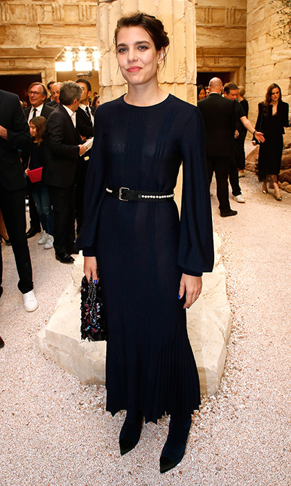 Princess Caroline's daughter Charlotte Casiraghi made an appearance in a long-sleeved navy dress – and matching nails! – at the Chanel Cruise 2017/2018 Collection Show at Grand Palais in Paris.