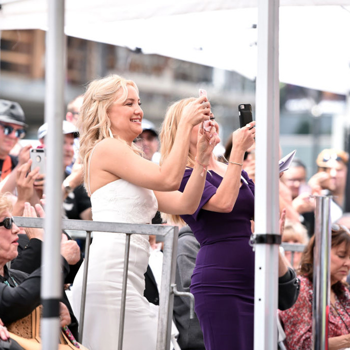 May 4: Kate Hudson, who was on hand for mom Goldie Hawn and Pa Kurt Russell's star reveal, cheered along with Reese Witherspoon at the Hollywood event.