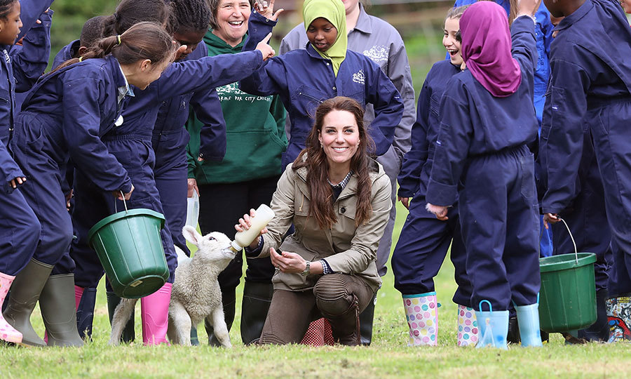Catherine, Duchess of Cambridge looked right at home as she visited Farms for City Children with a host of enthusiastic kids on May 3 in Arlingham, Gloucestershire, England. The charity offers children in the UK a chance to live and work on a real farm for a week.
