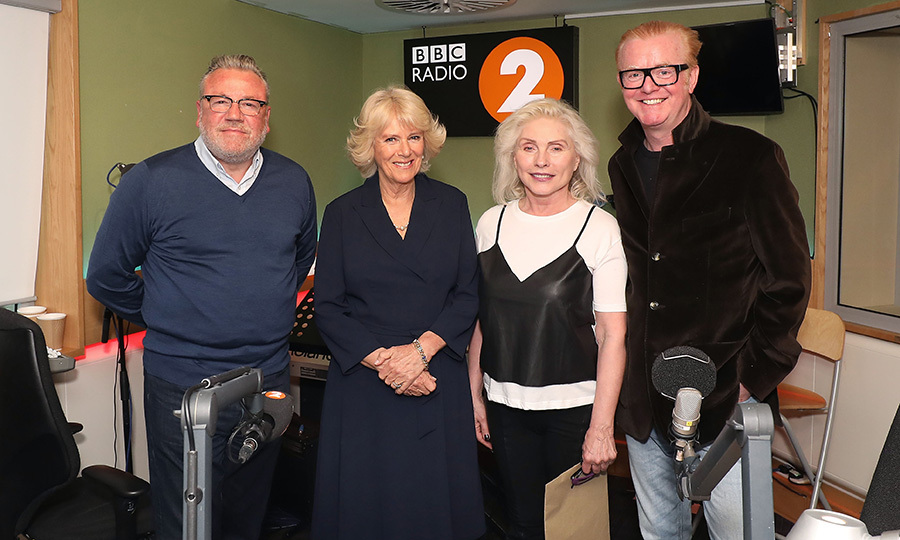 Camilla, Duchess of Cornwall joined music legend Debbie Harry from Blondie, along with British stars Ray Winstone and Chris Evans for the '500 Word' creative writing competition judging panel at BBC Radio 2 Studios in London on May 4. The royal told the rock singer she was a 'huge fan' and revealed that her own singing voice earned her the nickname 'the growler' back when she was in school.