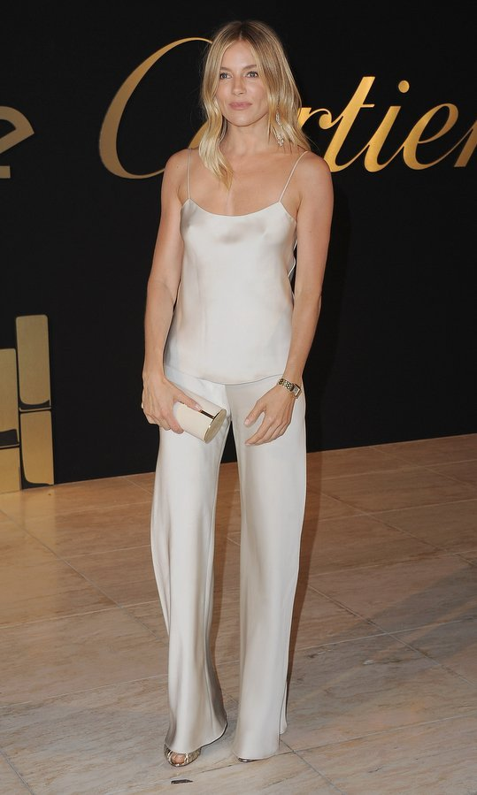 Actress Sienna Miller rocked the pajama trend in style in silky trousers and a camisole by The Row at the Panthere De Cartier Party In LA at Milk Studios in Los Angeles.