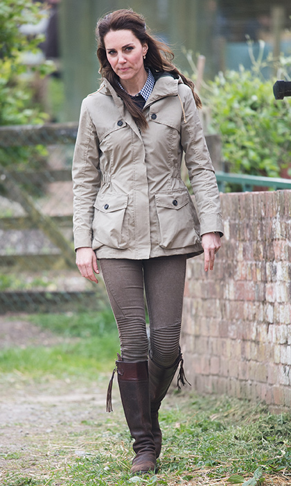 Catherine, Duchess of Cambridge dressed down in skinny jeans and her favorite boots for a visit to the Farms for City Children charity in Arlingham, Gloucestershire, England. 