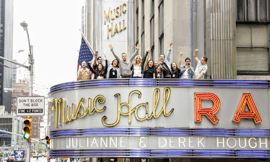 May 6: Talk about an entrance! Julianne and Derek Hough along with their dancers posed on top of the Radio City Music Hall marquee ahead of their Move – Beyond – Live on Tour.