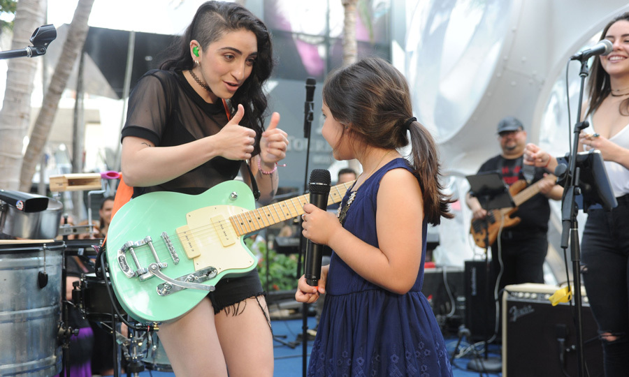 May 5: Emily Estefan performed for a crowd including her parents Emilio and Gloria at Miami Design Districts' Palm Court Plaza.