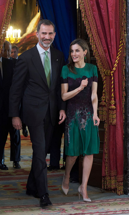 Queen Letizia pulled her green Carolina Herrera dress out of her closet for lunch with Costa Rica's President Luis Guillermo Solis and wife Mercedes Penas Domingo in Madrid. The stylish royal accessorized with her Bounkit earrings featuring a square Amethyst stone and Green Jade drop and D'Orsay pumps by Madrit.