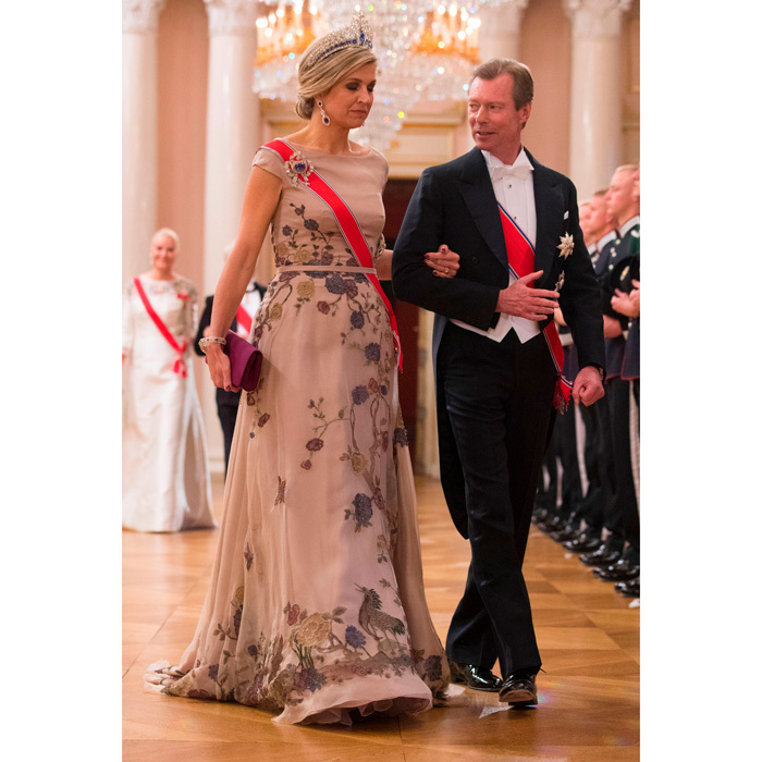 Queen Maxima wore a beige gown with floral and bird detail to King Harald and Queen Sonja's 80th birthday dinner at Norway's Royal Palace.