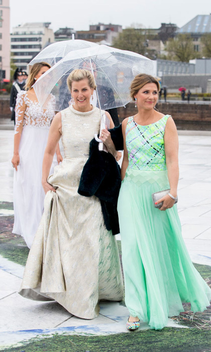 Sophie, Countess of Wessex stunned in a gold Suzannah dress as she entered the Opera House with Princess Martha Louise., who chose a mint green gown with matching shoes.