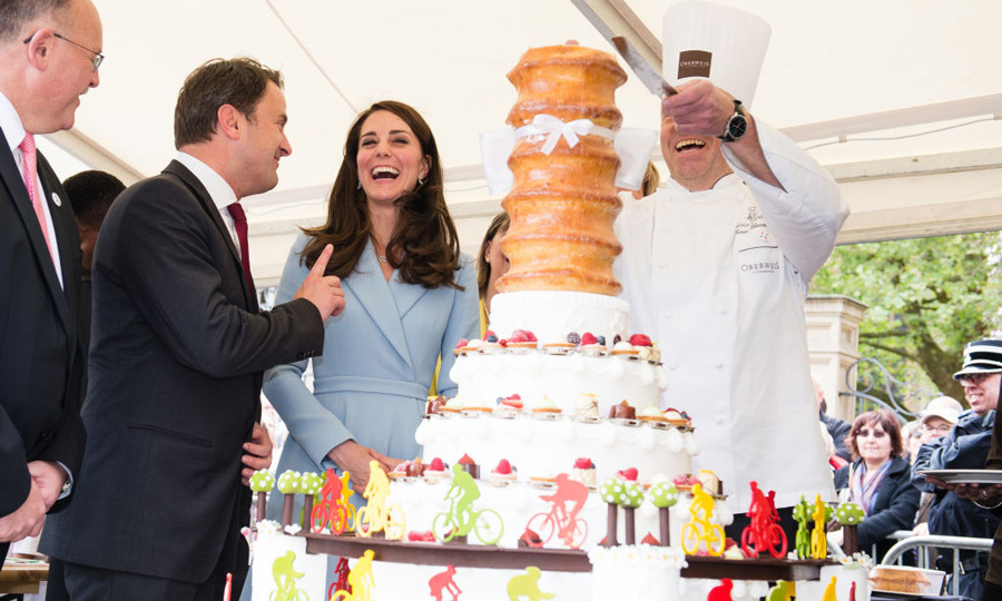"Kate watched chef Tom Oberweis cut into a traditional baumkuchen that was decorated with chocolate figures on bicycles. The Duchess was ""very complimentary,"" per the chef. He added, ""She asked how long it took to make and how we've made the decorations.""