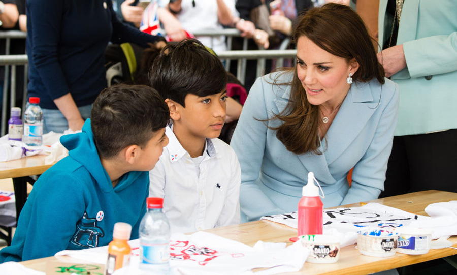 "The British royal took the time to meet with kids from after school programs as they decorated their own cycling jerseys. One 13-year-old girl Raquel shared that the Duchess has been ""really nice and really pretty."""
