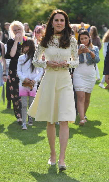 The Duchess of Cambridge looked as graceful as ever at the outdoor festivity, wearing one of her favorite dresses for the occasion. Designed by French fashion label Chloe, Kate's knitted cream dress swirled with springtime elegance. 