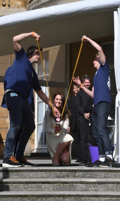 Kate gleefully launched a slingshot off the steps of the palace during the event.
