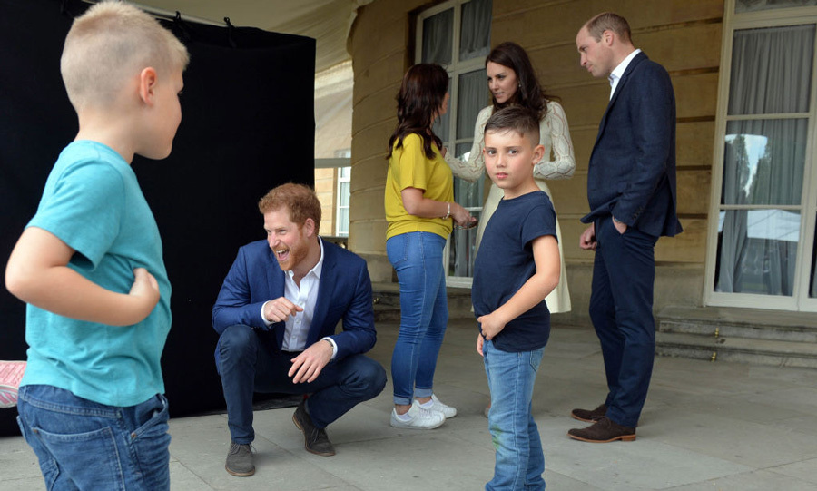 Prince Harry entertained the kids while his brother and sister-in-law spoke with Samantha, proving once again he is the best uncle!