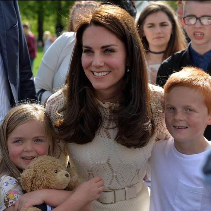 Kate sandwiched herself between a little girl and her stuffed animal and a ginger-haired boy during the tea party.