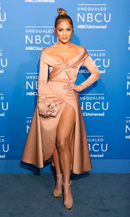 Jennifer Lopez wore Elie Saab to the NBC Universal Upfronts in NYC. The singer accessorized with Louboutin shoes and a $33,000 18K rose and white gold Narcisa Pheres floral cluster cocktail ring, which features 4.6 carat flawless diamonds.