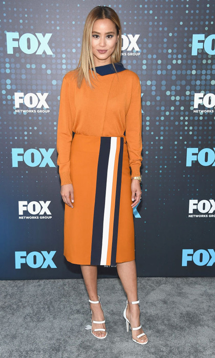 Jamie Chung promoted her new Fox show <i>Gifted</i> in NYC wearing an orange ensemble by Victoria Beckham with white sandals by Tamara Mellon.