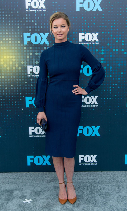 Emily VanCamp wore a navy blue Lela Rose dress but kept her accessories simple with her new engagement sparkler as she promoted her new Fox show <i>The Resident</i> in NYC.
