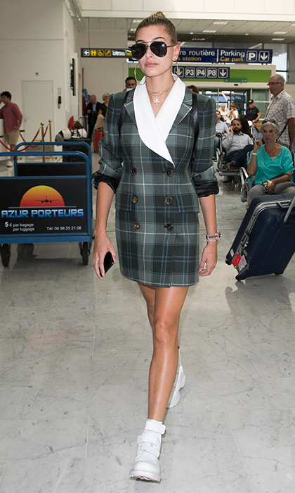 Hailey Baldwin channeled Princess Diana's double-breasted 1990s style at Nice airport in the run-up to Cannes.