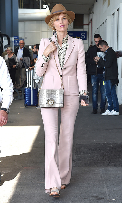 Supermodel Eva Herzigova suited up in pink as she arrived in Nice ready for the 70th annual Cannes Film Festival.