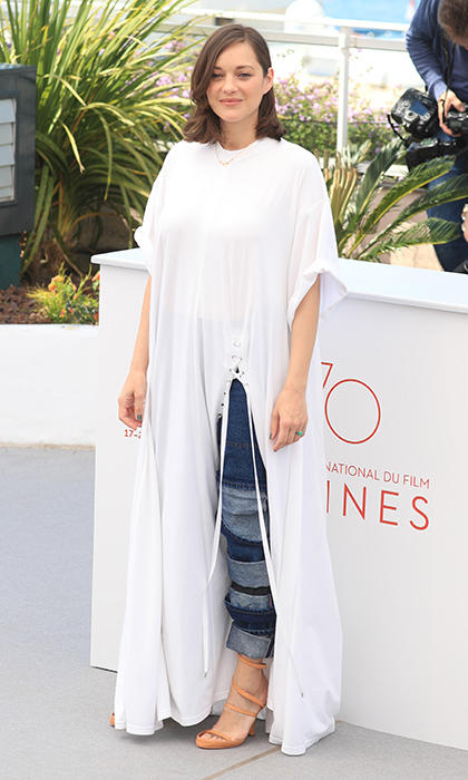 New mom Marion Cotillard returned to the spotlight for the <I>Ismael's Ghosts (Les Fantomes d'Ismael)</I> photocall at Palais des Festivals. 