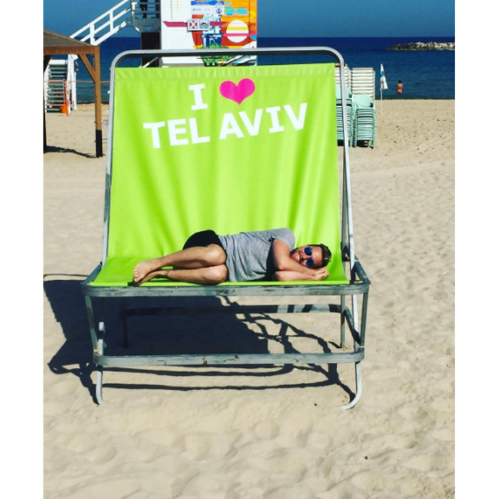 After being nonstop, Lance decided to take a break on an oversized chair in Tel Aviv. 
