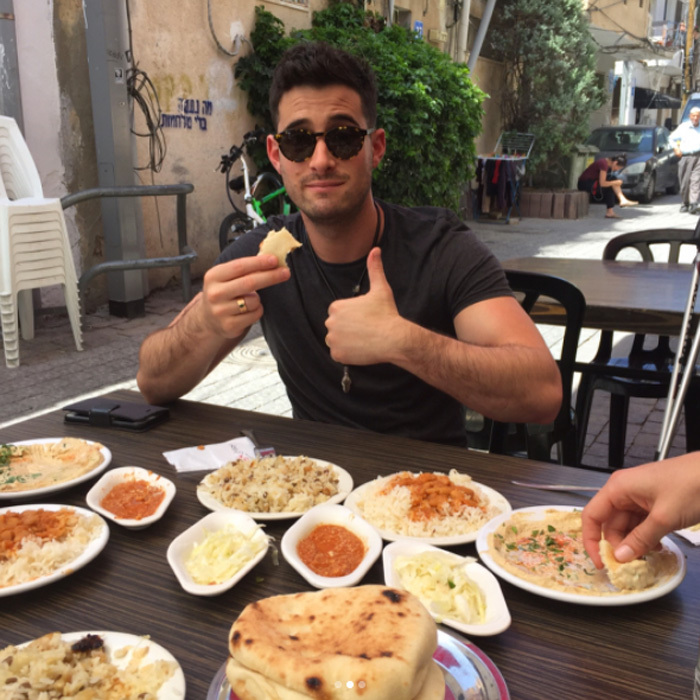 "The group feasted on hummus and local fare in Carmel Shuk market. Lance tells HELLO!: ""Talking politics and philosophy over amazing food with the locals made us feel like we were Anthony Bourdain."" 