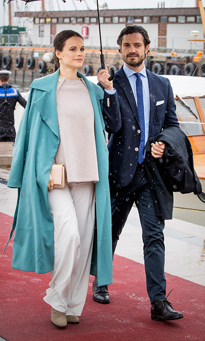 Escorted by husband Prince Carl Philip, pregnant Princess Sofia of Sweden was the picture of relaxed elegance in a knit sweater and turquoise duster for King Harald and Queen Sonja of Norway's 80th birthday lunch on the Royal yatch <I>Norge</I> in Oslo.