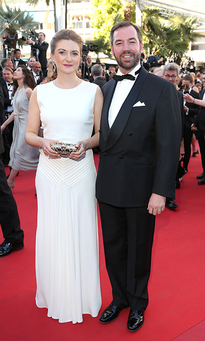 Wearing a white sleeveless Ralph Lauren gown, Princess Stephanie of Luxembourg stepped out with husband Prince Guillaume for the opening night screening of <I>Ismael's Ghosts (Les Fantomes d'Ismael) </I> at the 70th annual Cannes Film Festival. 