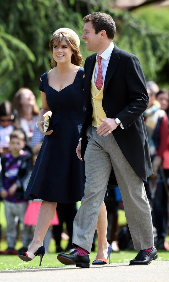 Princess Eugenie wore a pillbox hat and tailored Paule Ka dress as she and boyfriend Jack Brooksbank arrived for Pippa and James' wedding. 