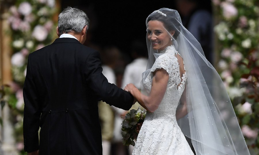 The beautiful bride stopped to smile at well-wishers gathered at St. Mark's church for her special day.