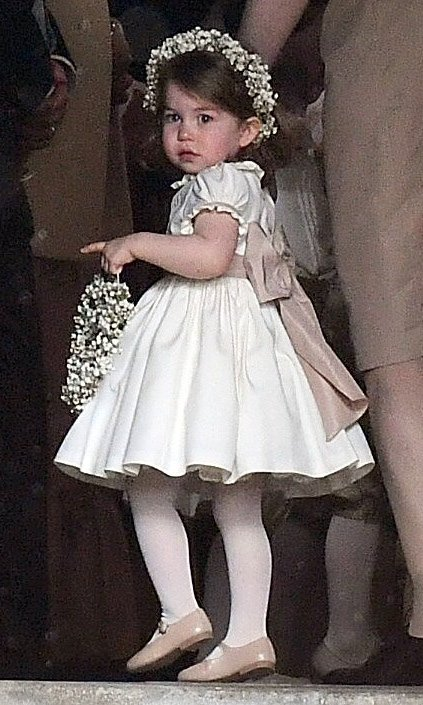 Prince William and Kate Middleton's daughter Princess Charlotte was adorable bearing flowers with a matching garland in her hair. 