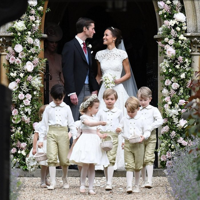 Walking behind their pageboys and flower girls, Pippa and James couldn't have looked happier as they emerged from the church as husband and wife.