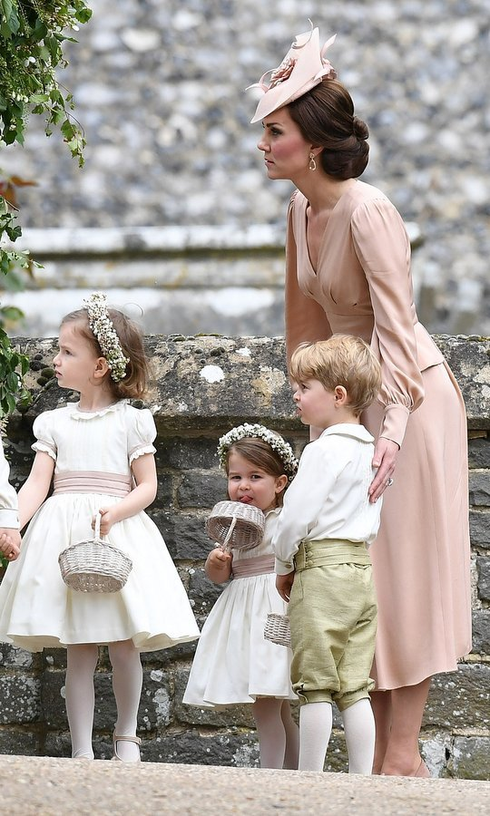 She's usually the center of attention but on this occasion Duchess Kate played a supporting role, helping to keep the wedding on track.