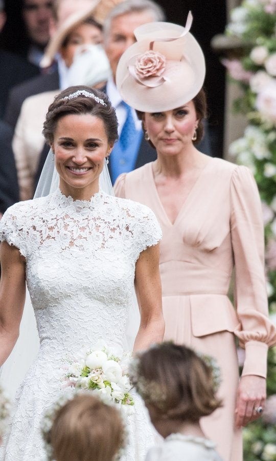 Kate followed her little sister's lead as the newlyweds left the church.