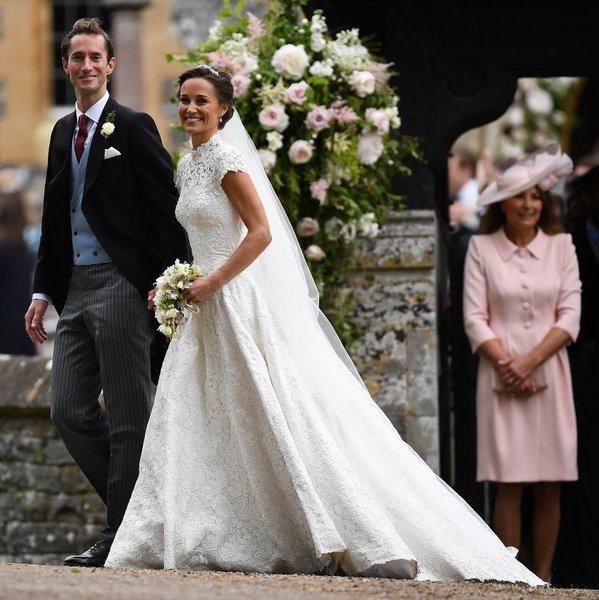 Proud mother-of-the bride Carole Middleton looked on as her daughter and new son-in-law left the church grounds.