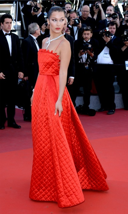 Bella Hadid wore a quilted red gown by Dior during the <i>Okja</i> screening.