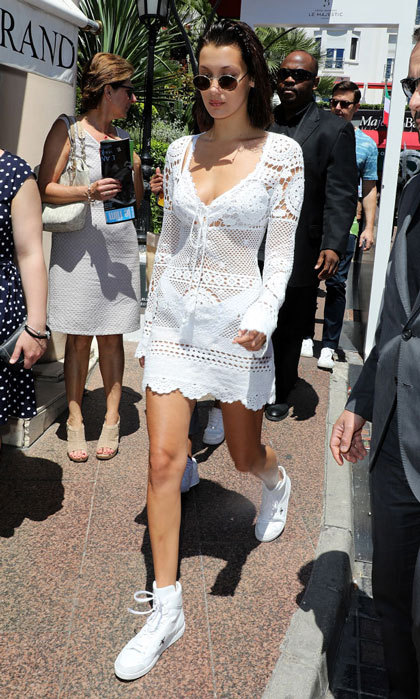 Bella Hadid strolled La Croisette in a white lace dress and white sneakers outside The Majestic Hotel.